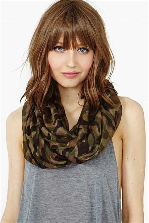 medium hairstyles with bangs for medium length blond curly style with pigtails and bangs
