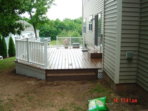 composite deck built onto a colonial home simply additions