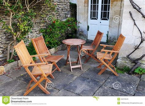 teak patio tables and chairs on brick deck royalty free stock photo cartoondealer 25023705