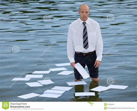 How To Float In Water While Standing by Portrait Of Businessman Standing In Lake With Papers