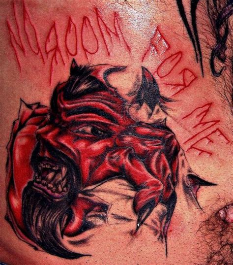 red demon tattoo bloody skin rip tattooimages biz