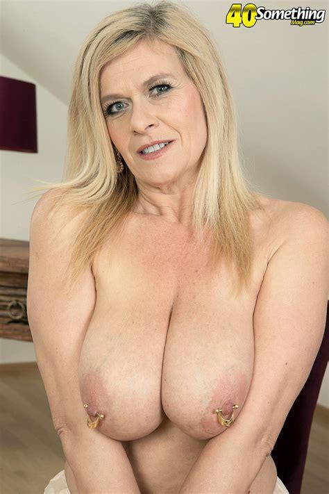 blonde mature mom marina rene undressing to flaunt pierced