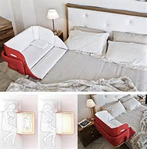 the culla stomach co sleeper attaches onto beds for easy