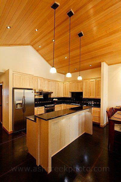 how to clean maple kitchen cabinets maple cabinets with black granite countertops very