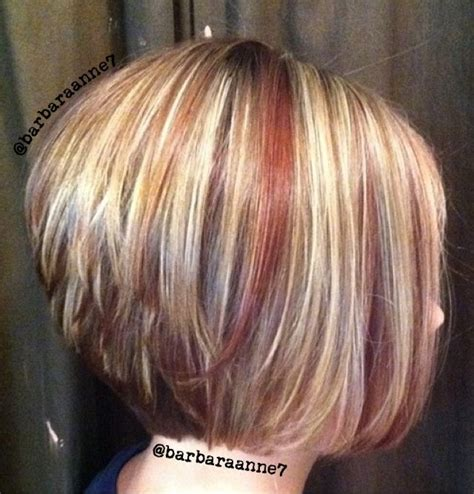 diagonal bob haircut curly hair dimensional color highlights lowlights blonde red
