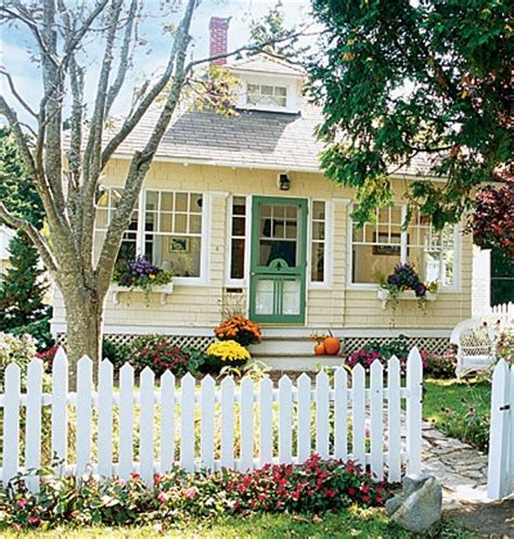 yellow and white houses picket fences green doors house dreams house