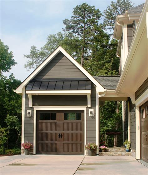 shed roof overhang with outdoor wall sconces garage