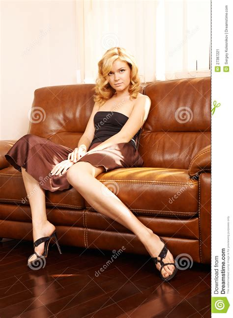 leather sofa porn young beautiful woman sitting on couch stock image image