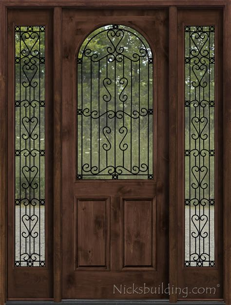 rustic entry door with wrought iron between glass