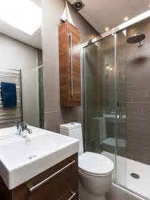 Eclectic bathroom photo in london with an alcove shower and gray tile