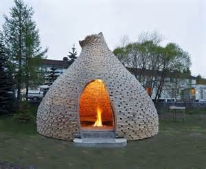 cozy outdoor fireplace hut is a warm glowing play place