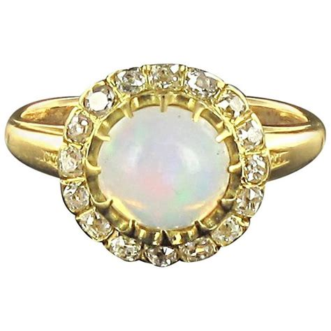 antique cabochon opal gold engagement ring for