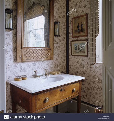 english country bathroom marble topped washstand in bathroom of english country