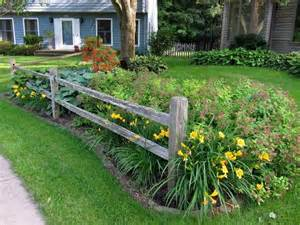 split rail fence installed by my husband to create an outdoor room for the front yard here