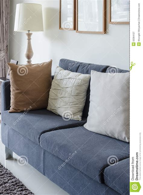 green fabric sofa with black and white pillow stock photo