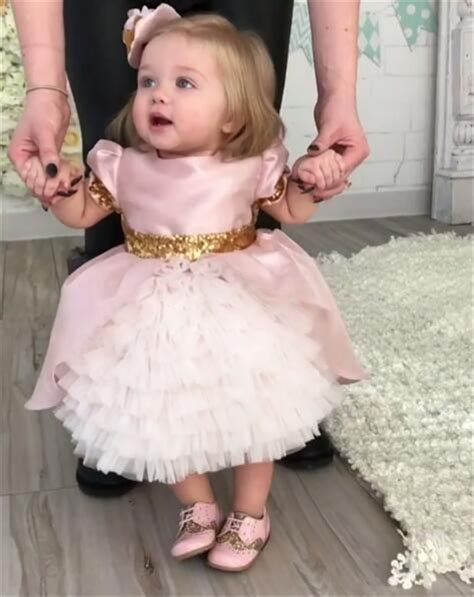 7 Sweet Dresses For Your Baby by Pink Baby Birthday Gown With Sequined Bow