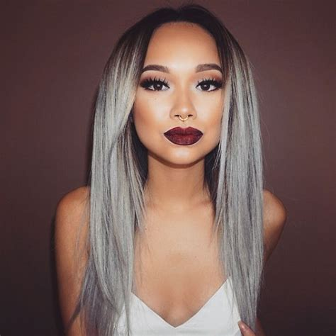 young women with gray granny hair trend young women are dyeing their hair