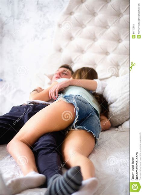 how to be on top in bed young love couple in bed girl lying on the boy s shoulder