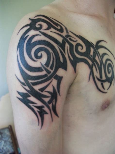 tribal chest to arm tattoo tribal tattoos arm and chest