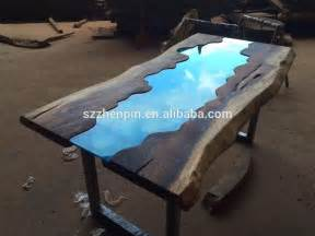 Glass wood dining table exotic wood and bronze dining