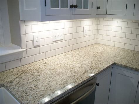 giallo ornamental granite backsplashes with giallo