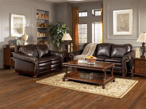 gray living room with brown furniture light wood floors with furniture or idolza