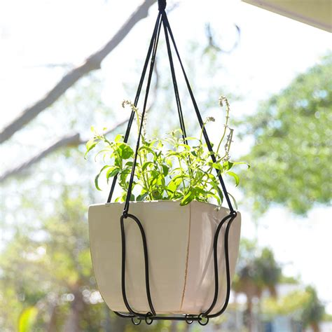 Outside Plant Hangers - adjustable plant hanger turns almost any pot into a