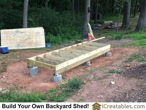 wood beams hold  floor framing  beams  attached