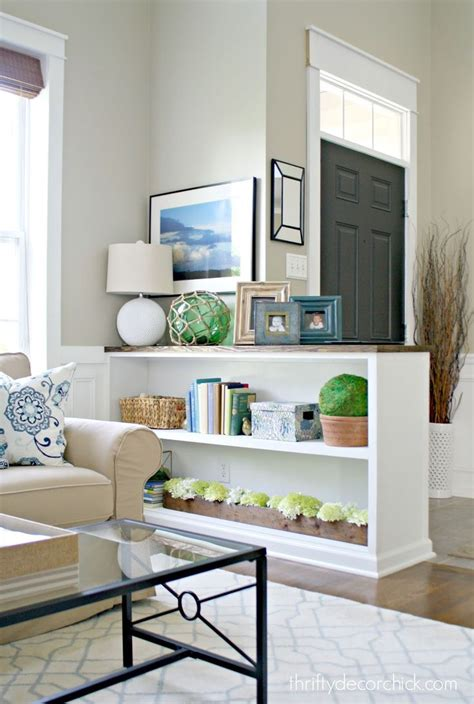 living room entryway finished half wall bookcase half walls walls and