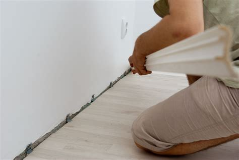 how to install wood floor without removing baseboards laminate flooring laminate flooring fixing gaps