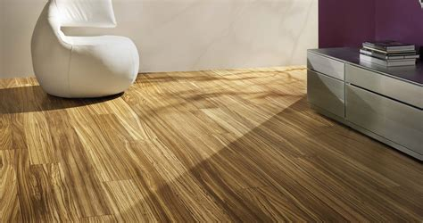 top king flooring best laminate wood flooring in living room with white leather lounge chair with back and rack