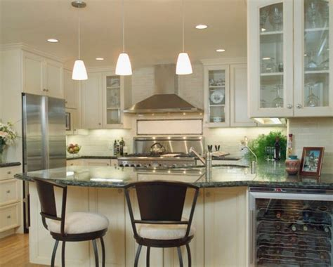 track lighting over kitchen island grey granite countertop and elegant white cabinet for