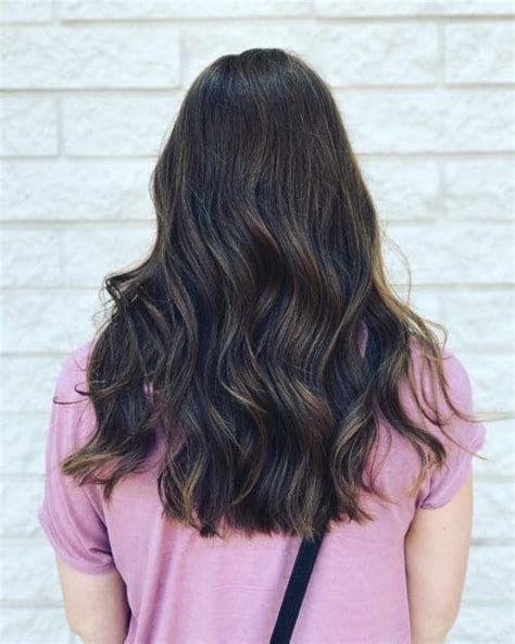 hair cut with a defined point in the back 43 cutest long layered haircuts trending in 2018