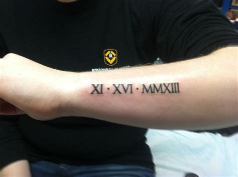 roman numeral forearm tattoo numerals of ian s birthday on my arm my