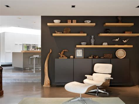 Floating wall shelves decorating ideas living room transitional with wall shelves leather pouf