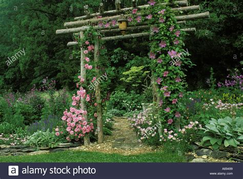 rustic flower garden rustic cedar arbor with roses and flagstone path in flower