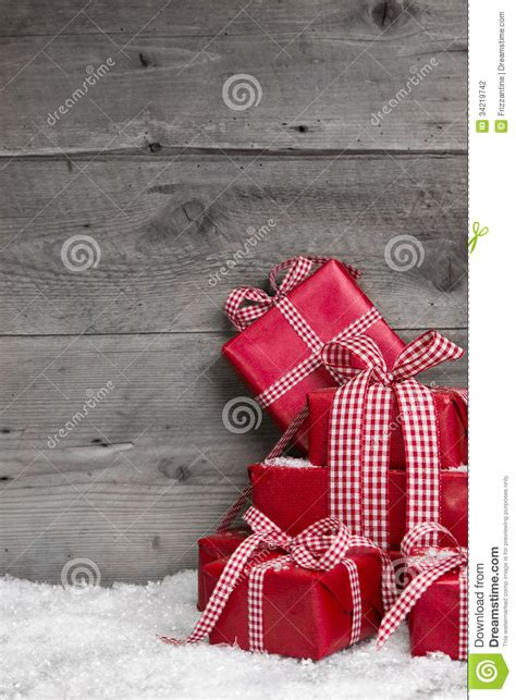 pile  red christmas gifts snow  grey wooden background stock photography image