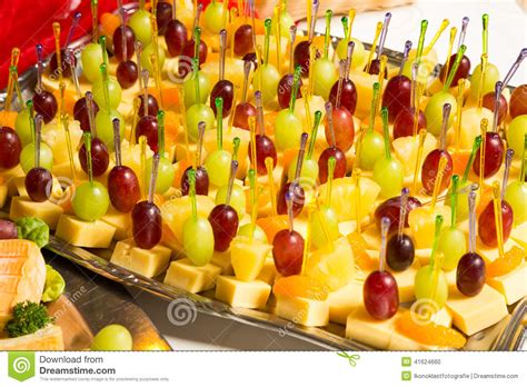 buffet with pineapple and grapes appetizers and other