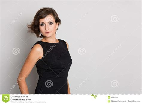 pic of 36 yr old woman with grey hair woman on a gray wall stock photo image 45539565