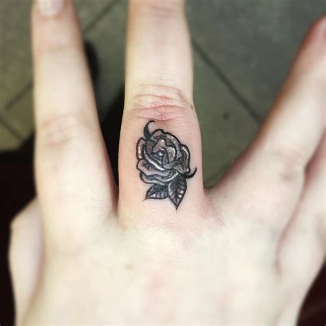 rose tattoo on your finger 67 different finger tattoo ideas that look great
