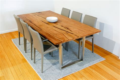 mondo marri dining table stained walnut with stainless