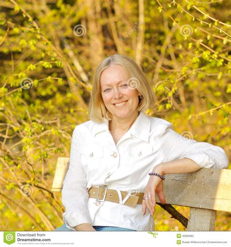 this pretty blond haired middle aged stock photo 86043952 middle aged blonde woman stock photo image 42950062