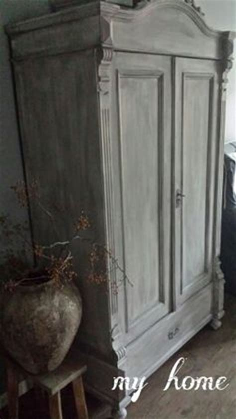 beautiful painted cabinet white washed top coat