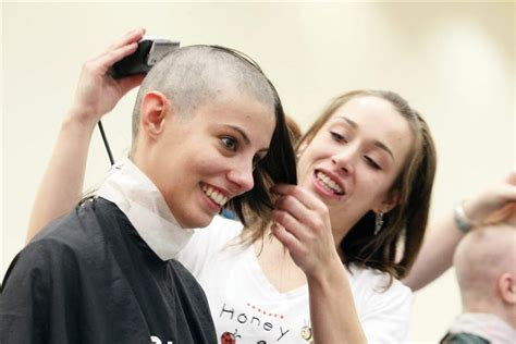 shaves head for cancer dozens shave heads cut locks for children s cancer