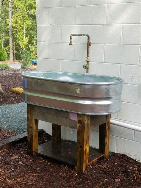 Outside Sinks by Stock Tank Sink Pallet Wood Base Pallets Garden Sink