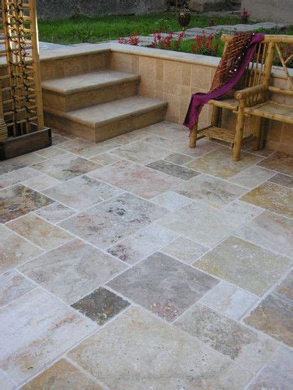 Tile Patio Ideas by Smooth Concrete Taped And Stained In Patchwork Of