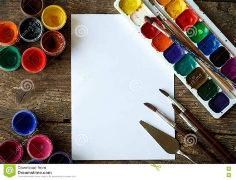 paper or paint paper watercolors and paint brush on wooden background