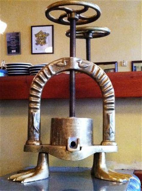 """an antique """"duck press"""" picture of le pichet, seattle"""