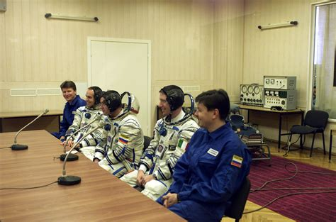 Background Check After Space In Images 2002 04 Last Checks After Marco Polo Crew Dons Spacesuit At