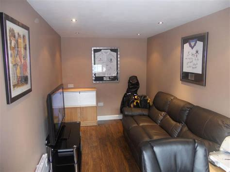 partial garage conversion  small rec space remodel
